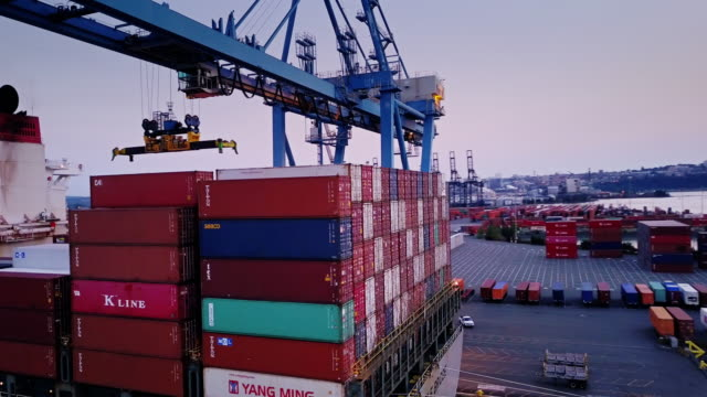 Gantry Crane Moving Over Loaded Container Ship
