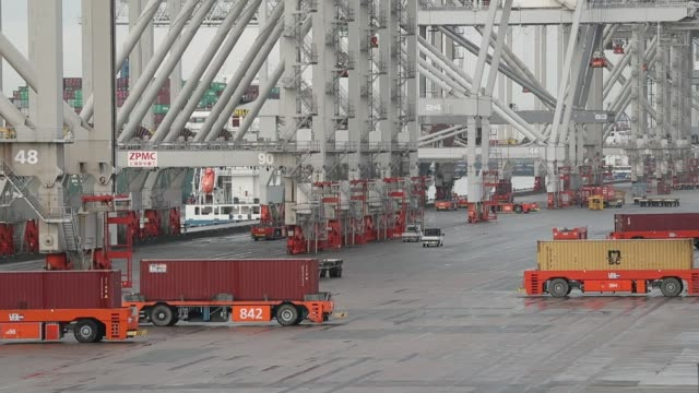 A gantry crane transports a shipping container at the Delta Terminal operated by Europe Container Terminals BV at the Port of Rotterdam in Rotterdam...