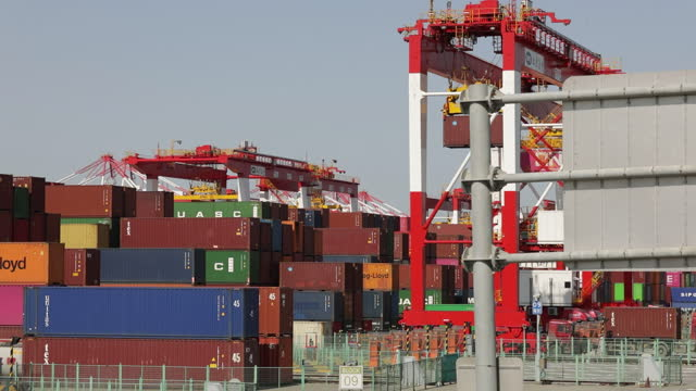 gantry crane working in port of shanghai ahead of trade figures release, in shanghai, china, on friday, april 9, 2021. china is scheduled to release... - container video stock e b–roll