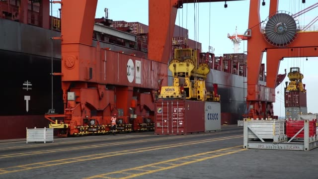 A gantry cranes unloads a container at Manila International Container Terminal MICT at the Port of Manila in Manila the Philippines on Friday Nov 20...