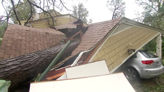 garage collapsed under the weight of a downed tree during hurricane florence on september 15, 2018 in wilmington, north carolina. - wilmington north carolina stock videos & royalty-free footage