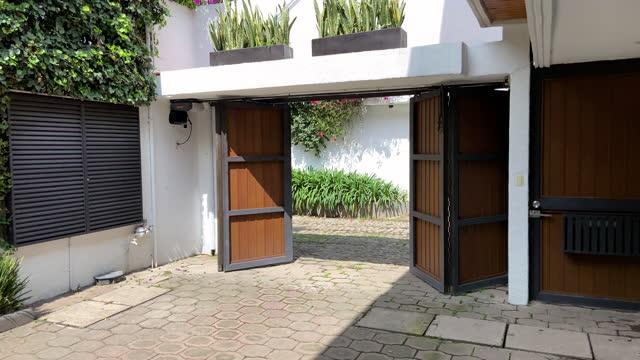 garage door opening - driveway stock videos & royalty-free footage