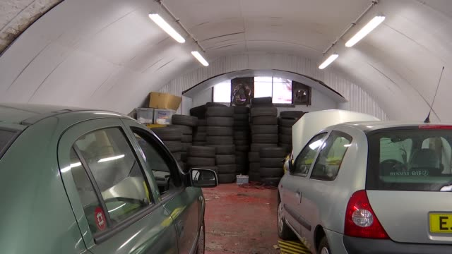 london lambeth clapham int cars in railway arch / cars and tyres in garage / mechanic doing tests on vehicle - lambeth stock videos & royalty-free footage