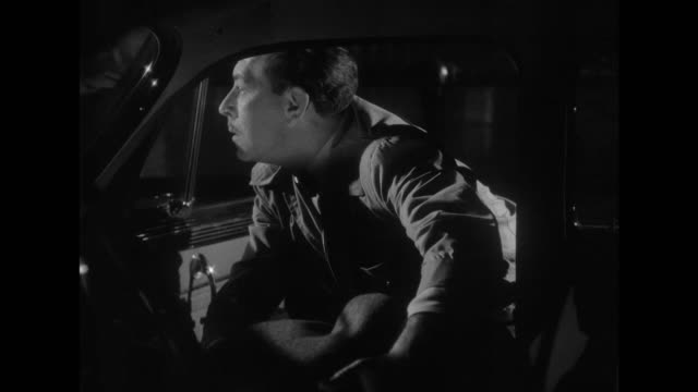 1948 a garage mechanic is offered help on side of road - film noir style stock videos and b-roll footage