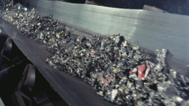 1976 montage garbage at a landfill falling from a crane and at a plant moving through cleaning process / hertfordshire, england, united kingdom - crane stock videos & royalty-free footage