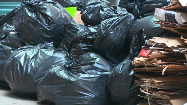 hd: garbage bags - bin bag stock videos & royalty-free footage