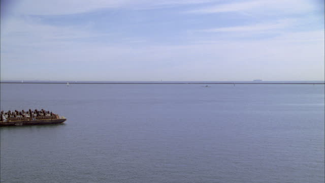 a garbage barge sails along the coast. - waste management stock videos & royalty-free footage