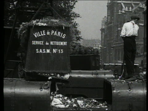b/w 1927 garbage bin being emptied into truck / garbage man / paris, france - garbage truck stock videos & royalty-free footage