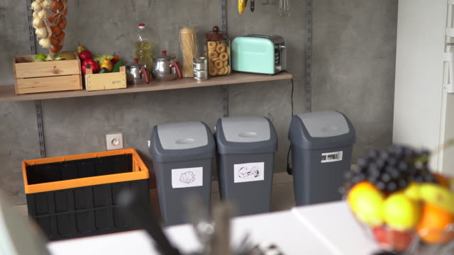 garbage bins for recycling at home - domestic kitchen stock videos & royalty-free footage