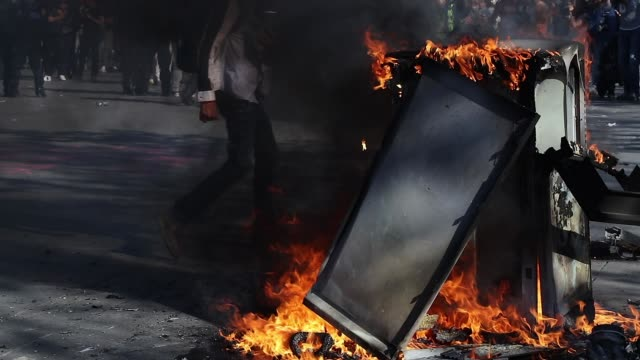 garbage can burning on the place of the republic. crowd of yellow vests and police - confrontation stock videos & royalty-free footage