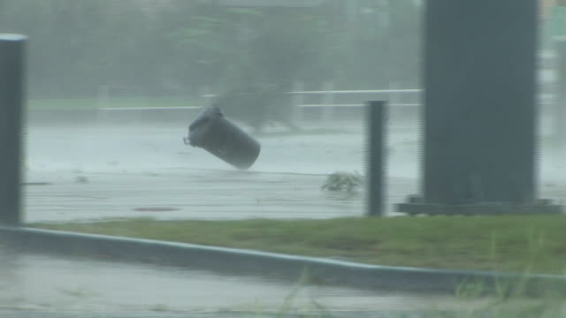 garbage can flies down street during height of hurricane gustav - 2013 stock videos & royalty-free footage