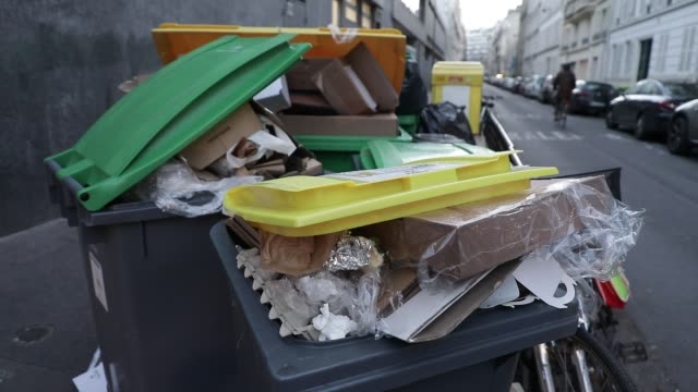 garbage cans filled with rubbish in the streets before the garbage collectors pass on january 17, 2020 in paris, france. - dustman stock videos & royalty-free footage