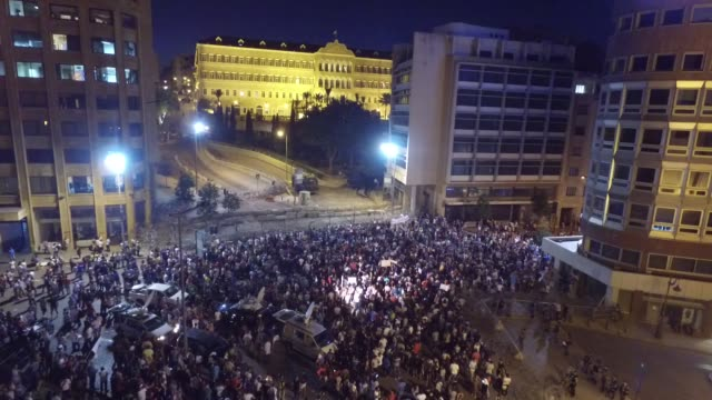 garbage crisis. night drone view of a crowd of people holding placards in riad el solh street, protesting the garbage crisis from the you-stink... - placard stock videos & royalty-free footage