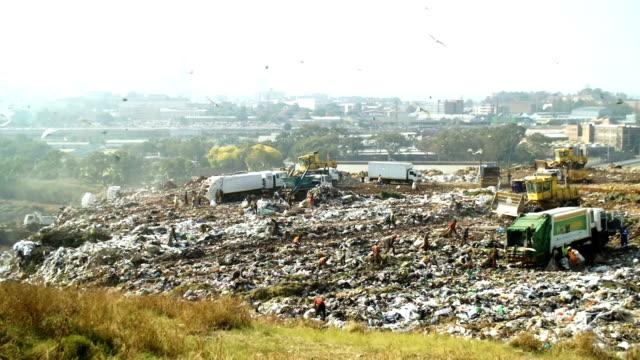 garbage dump, johannesburg, south africa - garbage truck stock videos & royalty-free footage