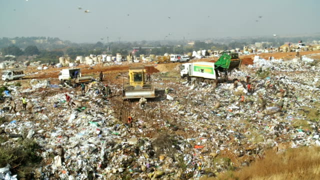 garbage dump, johannesburg, south africa - dump truck stock videos and b-roll footage