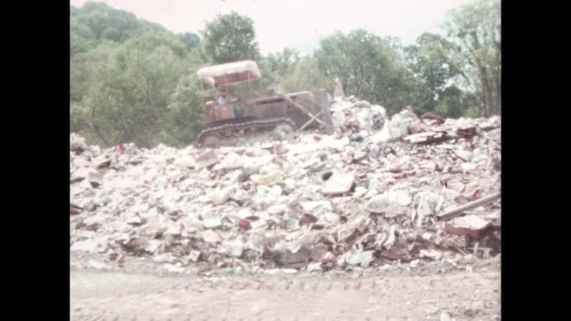garbage dump trash moved around by bulldozer - rubbish dump stock videos & royalty-free footage