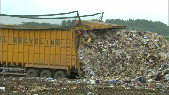 ms, garbage falling from dump truck on landfill site, ardley, oxfordshire, united kingdom - oxfordshire stock videos & royalty-free footage