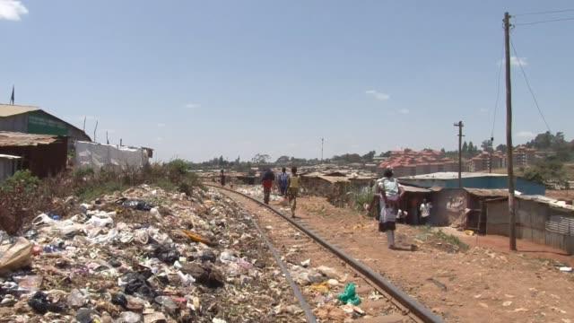 garbage kibera slum on february 13 2011 in nairobi kenya - ケニア点の映像素材/bロール