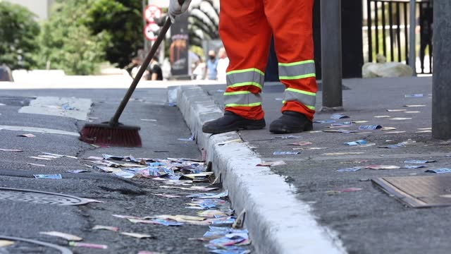 garbage man sweeps the street full of political pamphlets during municipal elections day on november 15, 2020 in sao paulo, brazil. in sao paulo, 13... - pamphlet stock videos & royalty-free footage