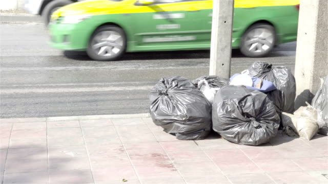 4k: garbage on the street. - bin bag stock videos & royalty-free footage