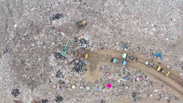 garbage or waste mountain or landfill, aerial view garbage trucks unload garbage to a landfill. plastic pollution crisis. - biohazard symbol stock videos and b-roll footage