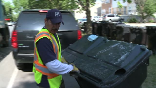 wgn garbage truck and sanitation workers on june 13 2012 in chicago illinois - bin bag stock videos & royalty-free footage