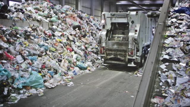 cs garbage truck driving away from conveyor belt - garbage truck stock videos and b-roll footage