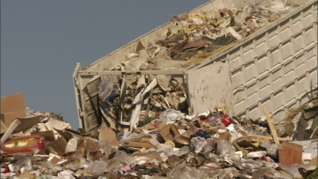 a garbage truck dumps trash at a landfill. - rubbish dump stock videos & royalty-free footage