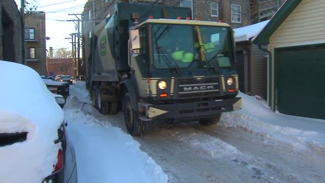Garbage Truck Going Down Alley