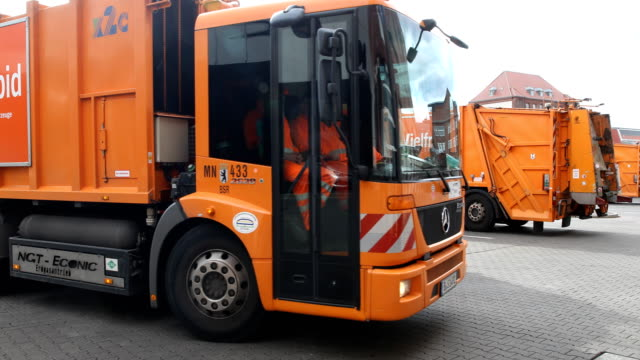 garbage truck is leaving the depot of the bsr on march 7, 2019 in berlin, germany. . in the background two garbage trucks can be seen with the... - garbage truck stock videos & royalty-free footage