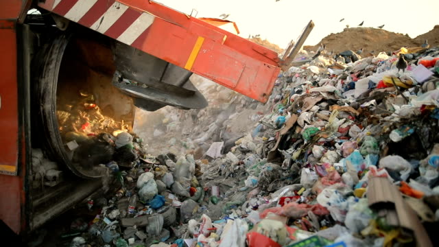 garbage truck on a landfill dumping the garbage.vehicle transporting garbage to waste - rubbish dump stock videos & royalty-free footage