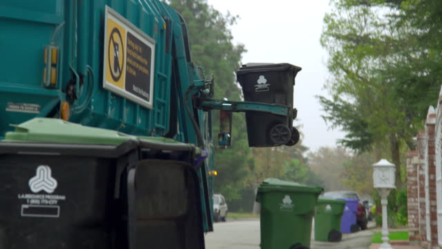 cu tu td garbage truck picking up garbage bins, north hollywood, california, usa - garbage truck stock videos and b-roll footage