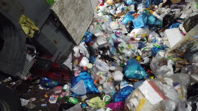 garbage truck unloading tons of trash - bin stock videos & royalty-free footage