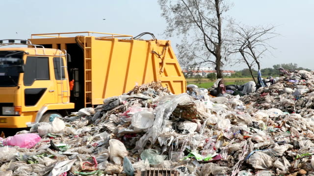 garbage truck - dump truck stock videos and b-roll footage