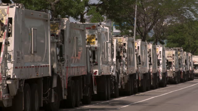 garbage trucks in a row in new york city. - garbage truck stock videos and b-roll footage