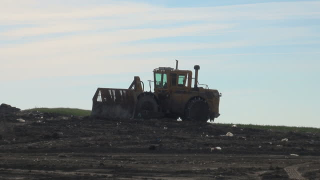 garbage waste dumped in the rubbish landfill site - bulldozer stock videos & royalty-free footage