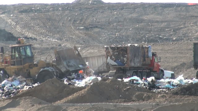 garbage waste dumped in the rubbish landfill site - dump truck stock videos and b-roll footage