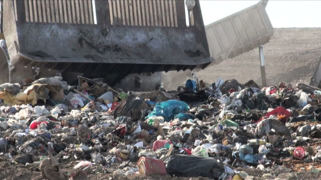 garbage waste dumped in the rubbish landfill site - garbage truck stock videos and b-roll footage