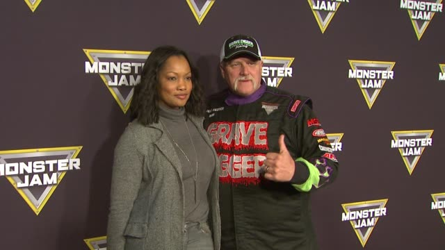 Garcelle Beauvais Madusa and Dennis Anderson at Monster Jam Celebrity Night at Angel Stadium of Anaheim on January 16 2016 in Anaheim California