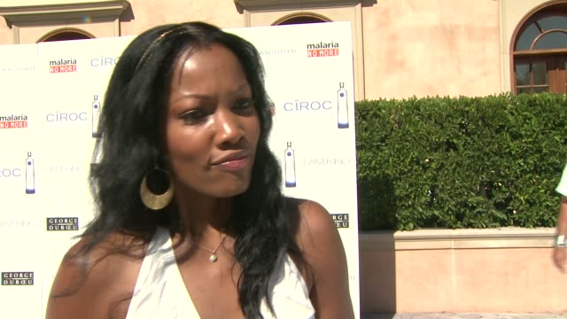 garcelle beauvais on finding a white dress, being a part of the day, shedding light on malaria no more, her favorite 4th of july memory, what makes... - 抜け殻点の映像素材/bロール