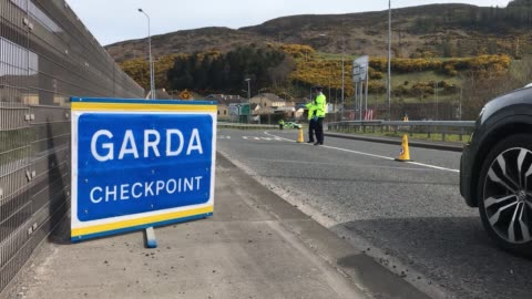 garda mount a coronavirus checkpoint on the border with northern ireland, at carrickcarnon in co louth. the police are cracking down non-essential... - northern ireland stock videos & royalty-free footage