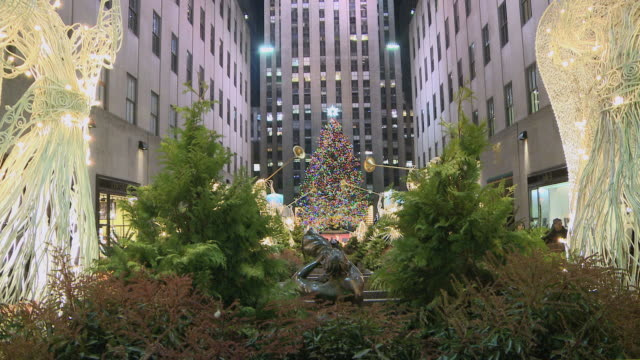 ms garden at rockefeller center with angel decorations / new york city, new york, usa - rockefeller center christmas tree stock videos & royalty-free footage