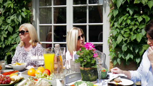garden buffet with friends - afternoon tea stock videos & royalty-free footage