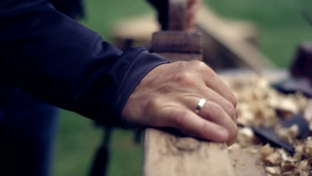 garden diy. man polishing wooden furniture. close-up. - mobilio video stock e b–roll