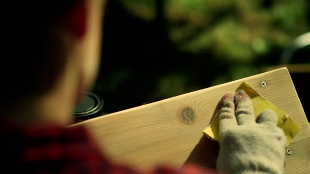 garden diy. woman polishing wooden furniture. close up on hands - polishing stock videos & royalty-free footage