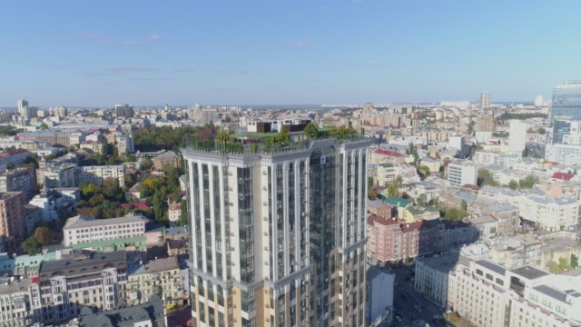 Garden on the roof of a 30-storey building in the city center. Aerial view