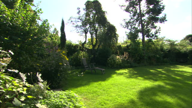 ws ha garden pan r-l - front or back yard stock videos & royalty-free footage