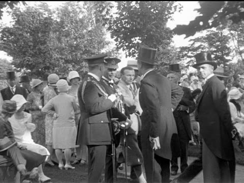 / garden party at rideau hall showing elegant guests sitting group of women singing guests and the royal guests milling around the newly dedicated... - parliament hill stock videos and b-roll footage
