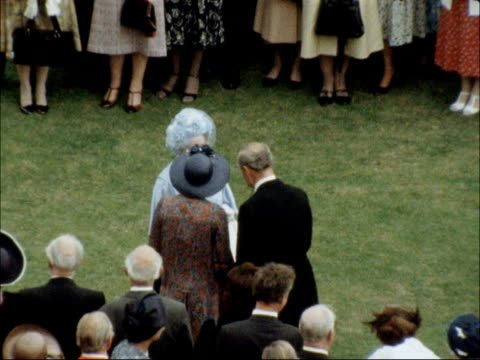 garden party held to mark queen mother's 80th birthday england london buckingham palace ext people attending garden party to mark the queen mother's... - milliner stock videos and b-roll footage