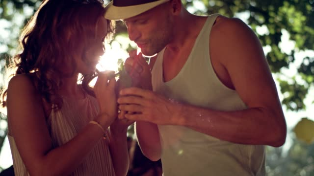 garden party. young people flirting and drinking tropical drink - tropical drink stock videos & royalty-free footage